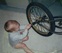 Matt Tennant as a kid with a bicycle