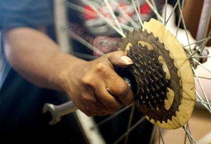 Fixing a bike wheel.